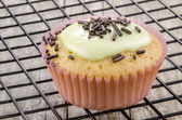 Cupcake with light green icing — Stock Photo