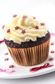 Home made cupcake with red stars — Stock Photo