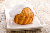 Freshly baked muffin with white icing — Stock Photo
