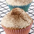 Cupcake with butter cream and coffee powder - Stock Photo