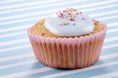 Vanilla cupcake with bright blue icing — Stock Photo