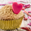 Valentine cupcake with red heart — Stock Photo