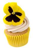 Madeira cupcake with edible pansy — Stock Photo