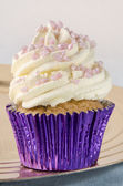 Cupcake with whipped double cream — Stock Photo