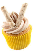Cupcake with cocoa butter cream and pepermint roll — Stock Photo