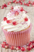 Cupcake with pomegranate and pink sprinkle — Stock Photo