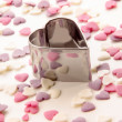 Cookie cutter and sugar hearts - Stock Photo