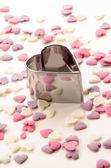 Cookie cutter and sugar hearts — Stock Photo