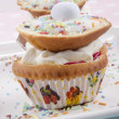 Cupcake with cream and easter egg — Stock Photo