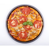Pizza with smoked trout and tomato — Stock Photo