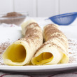 Two pancake with cocoa powder — Stock Photo