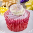 Stock Photo: Cupcake with strawberry buttercream