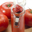 Tomatoes and tomato paste in a glass — Stock Photo #25448563