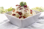 Mashed potato with grilled bacon — Stock Photo