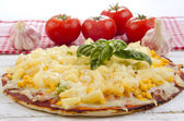 Pizza with pineapple and sweet corn — Stock Photo
