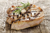 Grilled pork chop with peppercorns — Stock Photo