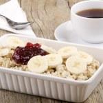 Porridge with banana slices and raspberry marmalade — Stock Photo #28400343