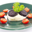 Mashed potato and black pudding — Stock Photo