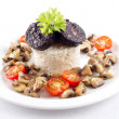 Rice with black pudding on plate — Stock Photo #29280821