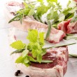 Stock Photo: Lamb chops and some herbs