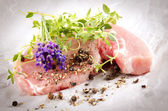 Raw pork chops with herbs — Stock Photo