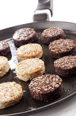 Black and white pudding on a pan — Stock Photo