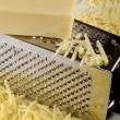 Grated cheddar cheese — Stock Photo