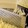 Stock Photo: Grated cheddar cheese