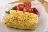 Grilled corn on the cob and tomato — Stock Photo