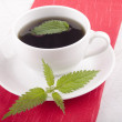 Stock Photo: Nettle tein white cup