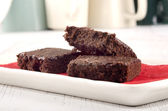 Home baked brownies on a plate — Stock Photo