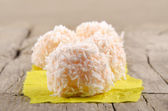 Strawberry champagne truffle with coconut flakes — Stock Photo