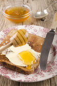Honey on a slice of toast — Stock Photo