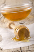 Honey dripper with some bee honey — Stock Photo