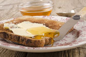Acacia honey on a slice of toast — Stock Photo