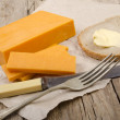 Irish mature cheddar cheese on paper — Stock Photo