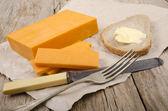 Irish mature cheddar cheese on paper — Stock Photo