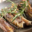 Spare ribs with rosemary in a pan — Stock Photo