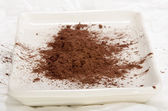 Cocoa powder on a plate — Stock Photo