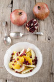 Fruit salad with pomegranate seeds — Stock Photo