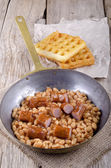 Baked beans with sausage and waffles — Stock Photo