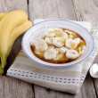 Rice pudding with banana slices — Stock Photo