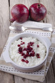 Rice pudding with pomegranate seed — Stock Photo