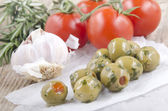 Spicy olive on white paper — Stock Photo