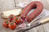 Spanish chorizo on white paper — Stock Photo