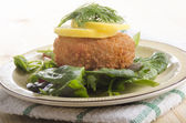 Smoked haddock fishcake on salad — Stock Photo