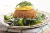 Smoked haddock fishcake on salad — Stock Photo