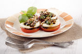 Salad caprese on a plate — Stock Photo