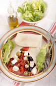Greek style crepe on a plate — Stock Photo