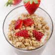 Yogurt with crunchy cereal and strawberry — Stock Photo